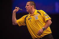 21.12.2014.  London, England.  William Hill World Darts Championship.  Dave Chisnall (8) [ENG] in action during his game with Ryan De Vreede [NED]. Chisnall won the match 3-0