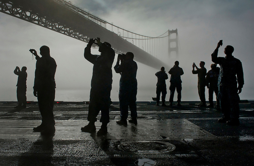 111011-N-DR144-995 SAN FRANCISCO (Oct. 11, 2011) Sailors take photos on the flight deck as Nimitz-class aircraft carrier USS Carl Vinson (CVN 70) passes under the Golden Gate Bridge while departing San Francisco. Carl Vinson was anchored in San Francisco, the ship's original homeport, participating in Fleet Week festivities.  U.S. Navy photo by Mass Communication Specialist 2nd Class James R. Evans (RELEASED)