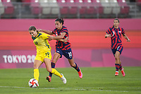 KASHIMA, JAPAN - AUGUST 5: Courtney Nevin #19 of Australia battles for the ball with Carli Lloyd #10 of the United States during a game between Australia and USWNT at Kashima Soccer Stadium on August 5, 2021 in Kashima, Japan.