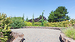 Garden Plaza with block walls and gravel surface in Tacoma, WA public utility environmental display garden.  At the Tacoma  Envirohouse.