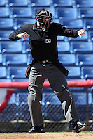 Home plate umpire Nick Lentz makes a call during a game between the Binghamton Mets and Akron Aeros at NYSEG Stadium on April 7, 2012 in Binghamton, New York.  Binghamton defeated Akron 2-1.  (Mike Janes/Four Seam Images)