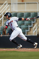 Carlos Perez (8) of the Kannapolis Intimidators follows through on his swing against the Greensboro Grasshoppers at Kannapolis Intimidators Stadium on August 5, 2018 in Kannapolis, North Carolina. The Intimidators defeated the Grasshoppers 9-0 in game two of a double-header.  (Brian Westerholt/Four Seam Images)