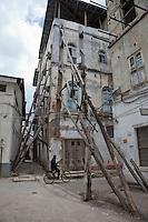 Zanzibar, Tanzania.  Bracing Building in Stone Town Against Collapse.