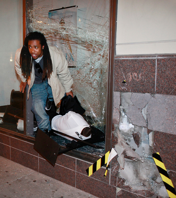 A demonstrator takes a mannequin after breaking the window at a downtown Sears store during a protest in Oakland, Calif., after a guilty verdict for Johannes Mehserle, Thursday, July 8, 2010.  Former San Francisco Bay Area Rapid Transit police officer Johannes Mehserle was found guilty in Los Angeles for shooting unarmed black man Oscar Grant on New Year's Day 2009 at a BART station in Oakland.  (AP Photo/Paul Sakuma)
