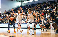 WASHINGTON, DC - FEBRUARY 22: Jamison Battle #10 and Arnaldo Toro #11 of George Washington close in on David Betty #1 of La Salle during a game between La Salle and George Washington at Charles E Smith Center on February 22, 2020 in Washington, DC.