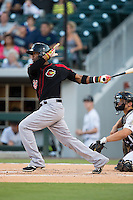 Carlos Paulino (20) of the Rochester Red Wings follows through on his swing against the Charlotte Knights at BB&T BallPark on August 8, 2015 in Charlotte, North Carolina.  The Red Wings defeated the Knights 3-0.  (Brian Westerholt/Four Seam Images)
