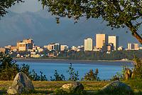 Anchorage Alaska city skyline, along the Cook Inlet at sunset. Anchorage, Alaska