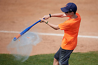 Batavia Muckdogs fan participates in an on field promotion to pop water balloons with a plastic bat during the first game of a doubleheader against the Mahoning Valley Scrappers on September 4, 2017 at Dwyer Stadium in Batavia, New York.  Mahoning Valley defeated Batavia 4-3.  (Mike Janes/Four Seam Images)