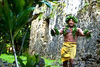 Hawaiian dancer adorned with laua'e leaf lei at a Hawaiian temple, O'ahu.