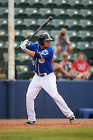 Biloxi Shuckers outfielder Tyrone Taylor (15) at bat during a game against the Birmingham Barons on May 24, 2015 at Joe Davis Stadium in Huntsville, Alabama.  Birmingham defeated Biloxi 6-4 as the Shuckers are playing all games on the road, or neutral sites like their former home in Huntsville, until the teams new stadium is completed in early June.  (Mike Janes/Four Seam Images)