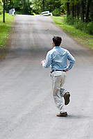 Man running on country road<br />