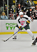 28 January 2012: University of Vermont Catamount forward Colin Markison, a Freshman from Princeton, NJ, in action against the visiting Northeastern University Huskies at Gutterson Fieldhouse in Burlington, Vermont. The Catamounts, dressed in their Breast Cancer Awareness jerseys, fell to the Huskies 4-2 in the second game of their 2-game Hockey East weekend series. Mandatory Credit: Ed Wolfstein Photo