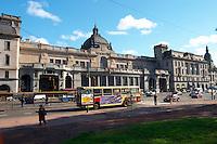 The Retiro train station FCG Mitre on the Plaza San Martin Square renamed Plaza de la Fuerza Aerea or Plaza Fuerza Retiro. City bus passing. Buenos Aires Argentina, South America