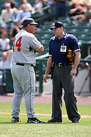 August 12 2008:  Home plate umpire Chris Bakke explains a call to Trent Jewitt during a game at Frontier Field in Rochester, NY.  Photo by:  Mike Janes/Four Seam Images