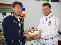 06-04-13, Tennis, Rumania, Brasov, Daviscup, Rumania-Netherlands,Birthday cake for Robin Haase presented by teamcaptain Jan Siemerink(r)