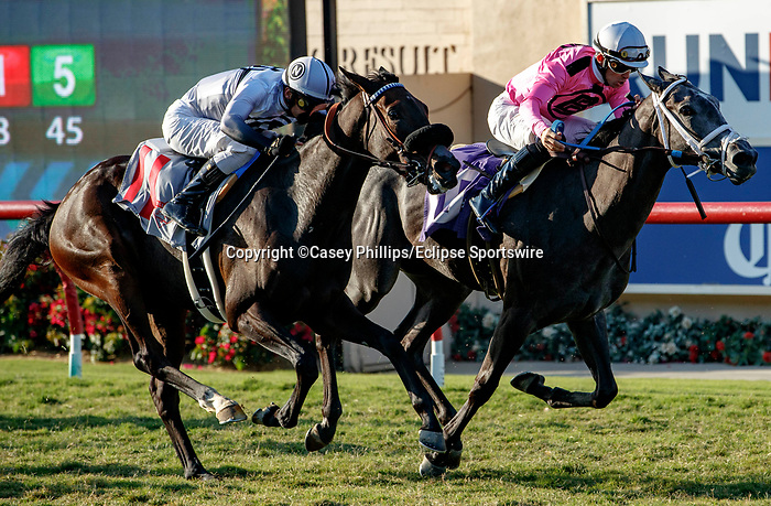 DEL MAR, CA  SEPTEMBER 5: #11 Helens Well, ridden by Flavien Prat, and #10 Liam's Dove, ridden by Kyle Frey, battle in the stretch of the Del Mar Juvenile Fillies Turf on September 5, 2021 at Del Mar Thoroughbred Club in Del Mar, CA.  (Photo by Casey Phillips/Eclipse Sportswire/CSM)