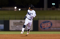 AFL West left fielder Buddy Reed (85), of the Peoria Javelinas and San Diego Padres organization, hustles towards third base during the Arizona Fall League Fall Stars game at Surprise Stadium on November 3, 2018 in Surprise, Arizona. The AFL West defeated the AFL East 7-6 . (Zachary Lucy/Four Seam Images)