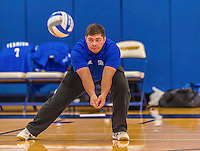 26 October 2014: Yeshiva University Maccabee Assistant Coach Grigory Agrest, instructs team members prior to a game against the College of Mount Saint Vincent Dolphins, in Riverdale, NY. The Dolphins defeated the Maccabees 3-0 in the NCAA Division III Women's Volleyball Skyline matchup. Mandatory Credit: Ed Wolfstein Photo *** RAW (NEF) Image File Available ***