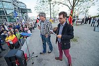 """Baergida Montagsdemonstration in Berlin.<br /> Ca. 150 Anhaenger des Berliner Pegida-Ablegers """"Baergida"""" zogen mit einer Demonstration vom Hauptbahnhof zum Roten Rathaus. Unter den Teilnehmern waren wie immer etwa 30-35 Fussball-Hooligans, sog. """"Reichsbuerger"""", Verschwoerungstheoretiker und Rechtsradikale. Die Demonstranten riefen immer wieder Parolen wie gegen anwesende Journalisten und gegen die Bundesregierung. Ein Journalist, der in der Vorwoche von Baergida-Anhaengern verpruegelt und verletzt wurde, wurde erneut verbal bedroht.<br /> Im Bild vlnr.: Baergida- und Patrioten e.V.-Initiator Karl Schmitt und Baergida-Pressesprecher """"Reiner Zufall"""" alias Heribert Eisenhardt vom AfD-Kreisverband Lichtenberg. An einer Kette traegt Eisenhardt ein bei Rechten beliebtes Keltenkreuz.<br /> 4.5.2015, Berlin<br /> Copyright: Christian-Ditsch.de<br /> [Inhaltsveraendernde Manipulation des Fotos nur nach ausdruecklicher Genehmigung des Fotografen. Vereinbarungen ueber Abtretung von Persoenlichkeitsrechten/Model Release der abgebildeten Person/Personen liegen nicht vor. NO MODEL RELEASE! Nur fuer Redaktionelle Zwecke. Don't publish without copyright Christian-Ditsch.de, Veroeffentlichung nur mit Fotografennennung, sowie gegen Honorar, MwSt. und Beleg. Konto: I N G - D i B a, IBAN DE58500105175400192269, BIC INGDDEFFXXX, Kontakt: post@christian-ditsch.de<br /> Bei der Bearbeitung der Dateiinformationen darf die Urheberkennzeichnung in den EXIF- und  IPTC-Daten nicht entfernt werden, diese sind in digitalen Medien nach §95c UrhG rechtlich geschuetzt. Der Urhebervermerk wird gemaess §13 UrhG verlangt.]"""