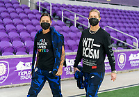 ORLANDO, FL - JANUARY 18: Ali Krieger #11 and Ashlyn Harris #18 of the USWNT walk into the venue before a game between Colombia and USWNT at Exploria Stadium on January 18, 2021 in Orlando, Florida.