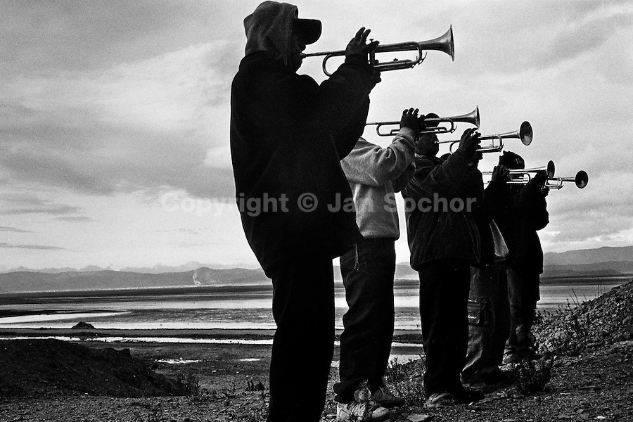 Bolivian boys play trumpets on a vast mountain plateau during the festival of Our Lady of Mount Carmel, Oruro, Bolivia, 17 July 2002.