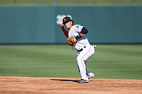 Salt River Rafters shortstop Bryson Brigman (15), of the Miami Marlins organization, throws to first base during an Arizona Fall League game against the Surprise Saguaros at Salt River Fields at Talking Stick on November 5, 2018 in Scottsdale, Arizona. Salt River defeated Surprise 4-3 . (Zachary Lucy/Four Seam Images)