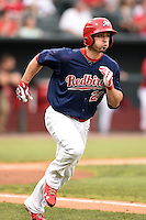 Memphis Redbirds outfielder Randal Grichuk (21) runs to first during a game against the Oklahoma City RedHawks on May 23, 2014 at AutoZone Park in Memphis, Tennessee.  Oklahoma City defeated Memphis 12-10.  (Mike Janes/Four Seam Images)