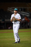 Salt River Rafters starting pitcher Nick Neidert (15), of the Miami Marlins organization, walks off the field between innings of an Arizona Fall League game against the Naranjeros de Hermosillo on September 24, 2019 at Salt River Fields at Talking Stick in Phoenix, Arizona. Salt River defeated Hermosillo 4-1. The Naranjeros, of the Mexican Pacific League, played in Scottsdale as part of the Mexican baseball Fiesta. (Zachary Lucy/Four Seam Images)