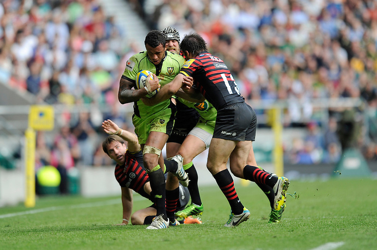 Courtney Lawes of Northampton Saints is tackled by Marcelo Bosch of Saracens during the Aviva Premiership Final between Saracens and Northampton Saints at Twickenham Stadium on Saturday 31st May 2014 (Photo by Rob Munro)