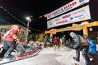 Mitch Seavey runs into the chute at the finish line in Nome, Alaska early on Wednesday morning March 14th as he places 3rd in the 46th running of the 2018 Iditarod Sled Dog Race.  <br /> <br /> Photo by Jeff Schultz/SchultzPhoto.com  (C) 2018  ALL RIGHTS RESERVED