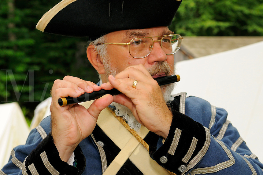 Fifer plays at a Revolutionary War encampment, Old Sturbridge Village, Massachusetts, USA.