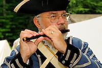 Fifer plays at a Revolutionary War encampment, Old Sturbridge Village, Massachusetts, USA.