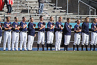 University of Virginia Cavaliers team during the playing of the national anthem before a game against the University of Kentucky Wildcats at Brooks Field on the campus of the University of North Carolina at Wilmington on February 14, 2014 in Wilmington, North Carolina. Kentucky defeated Virginia by the score of 8-3. (Robert Gurganus/Four Seam Images)