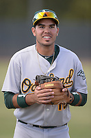Oakland Athletics third baseman Renato Nunez (18) during warmups before an Instructional League game against the Milwaukee Brewers on October 10, 2013 at Maryvale Baseball Park Training Complex in Phoenix, Arizona.  (Mike Janes/Four Seam Images)