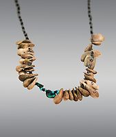 Neolithic necklace, 7000 BC to 6500 BC . Catalhoyuk collection, Konya Archaeological Museum, Turkey. Against a gray background