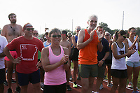 Attendees prepare to go on a run, Monday, August 2, 2021 at the Old Tiger Track in Bentonville. The Bentonville Parks and Recreation Department held a grand reopening of the Old Tiger Track. As the only public use track in the area, the new surface has designated lanes for training and competitive use. The oval track is bordered with pedestrian-level lights, extending daily usage from pre-dawn to evening. The installation of new restroom facilities provides an added bonus, along with a 10' expansion of the trail width along Northwest D Street. Construction costs for the track renovations and enhancements totaled $585,000. Tiger Track was originally the home of Bentonville High School's Tiger Stadium and Track Field. Parks and Recreation acquired the property in 2010 for use as a city park. Check out nwaonline.com/210803Daily/ for today's photo gallery. <br /> (NWA Democrat-Gazette/Charlie Kaijo)