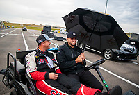 Oct 3, 2020; Madison, Illinois, USA; NHRA top fuel driver Steve Torrence with crew member Gary Pritchett during qualifying for the Midwest Nationals at World Wide Technology Raceway. Mandatory Credit: Mark J. Rebilas-USA TODAY Sports