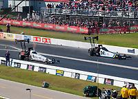 Apr 14, 2019; Baytown, TX, USA; NHRA top fuel driver Austin Prock (left) races alongside Jordan Vandergriff during the Springnationals at Houston Raceway Park. Mandatory Credit: Mark J. Rebilas-USA TODAY Sports