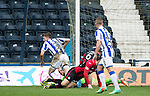 Kilmarnock v St Johnstone...05.04.14    SPFL<br /> Robbie Muirhead scores for Killie<br /> Picture by Graeme Hart.<br /> Copyright Perthshire Picture Agency<br /> Tel: 01738 623350  Mobile: 07990 594431