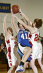 LITCHFIELD, CT, 01/03/08- 010308BZ08- Shepaug's Sam Steinmetz (41) fights for the rebound against Wamogo's Nikkie Sidall (11) and Abbeigh Bennett (23) during their game at Wamogo High School in Litchfield Thursday night.<br /> Jamison C. Bazinet Republican-American