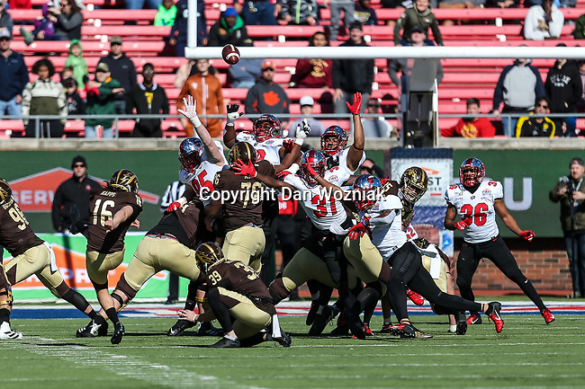 Western Michigan Broncos place kicker Thiago Kapps (16) in action during the Servpro First Responder Bowl game between Western Michigan Broncos and the Western Kentucky Hilltoppers at the gerald Ford Stadiuml Stadium in Dallas, Texas.