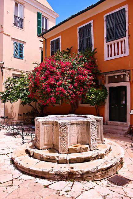 1690 Venetian well of Antonio Cocchini.  Campiello area of Corfu Old Town, Greek Ionian Islands