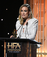 """BEVERLY HILLS - NOVEMBER 3: Olivia Wilde accepts the Hollywood Breakthrough Director Award for """"Booksmart"""" onstage at the 2019 Hollywood Film Awards at the Beverly Hilton on November 3, 2019 in Beverly Hills, California. (Photo by Frank Micelotta/PictureGroup)"""
