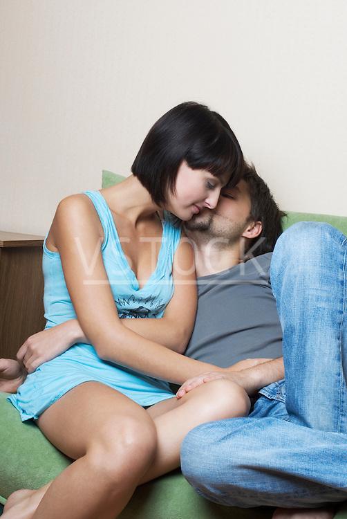 Affectionate couple on sofa