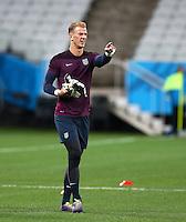 Joe Hart of England points during training ahead of tomorrow's Group D match vs Uruguay