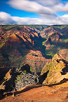 Waimea Canyon, the Grand Canyon of the Pacific, with all its color has tremendous views as clouds stream past.