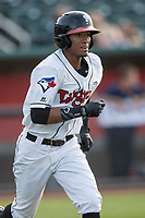 Lansing Lugnuts outfielder Edward Olivares (1) runs to first base during the Midwest League baseball game against the Bowling Green Hot Rods on June 29, 2017 at Cooley Law School Stadium in Lansing, Michigan. Bowling Green defeated Lansing 11-9 in 10 innings. (Andrew Woolley/Four Seam Images)