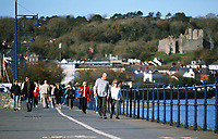People enjoy a walk in Mumbles near Swansea, Wales, UK. Friday 27 October 2017