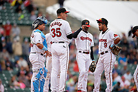 Rochester Red Wings manager Joel Skinner (35) makes a pitching change as catcher Willians Astudillo, shortstop Nick Gordon, and second baseman Luis Arraez (9) look on during an International League game against the Charlotte Knights on June 16, 2019 at Frontier Field in Rochester, New York.  Rochester defeated Charlotte 3-2 in the second game of a doubleheader.  (Mike Janes/Four Seam Images)