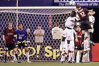 The MetroStars' Jeff Parke goes up for a header against the Burn's Eddie Johnson and Steve Jolley as the Burn's goalkeeper Jeff Cassar, the MetroStars' Eddie Gaven, and teammate Sergio Galvan Rey watch. The Dallas Burn defeated the MetroStars 1-0 at Giant's Stadium, East Rutherford, NJ, on August 15, 2004.
